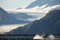 A boat carrying President Barack Obama makes its way to Bear Glacier, which has receded 1.8 miles in approximately 100 years while on a boat tour to see the effects of global warming in Resurrection Cove, Tuesday, Sept. 1, 2015, in Seward, Alaska. (Photo Credit: AP/Andrew Harnik) Click to Enlarge.
