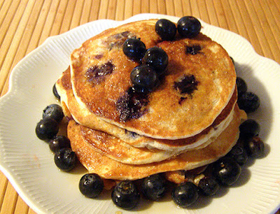 Blueberry Pancakes Garnished with Blueberries and Maple Syrup