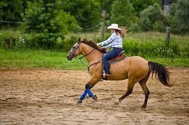 girl riding a cowboy