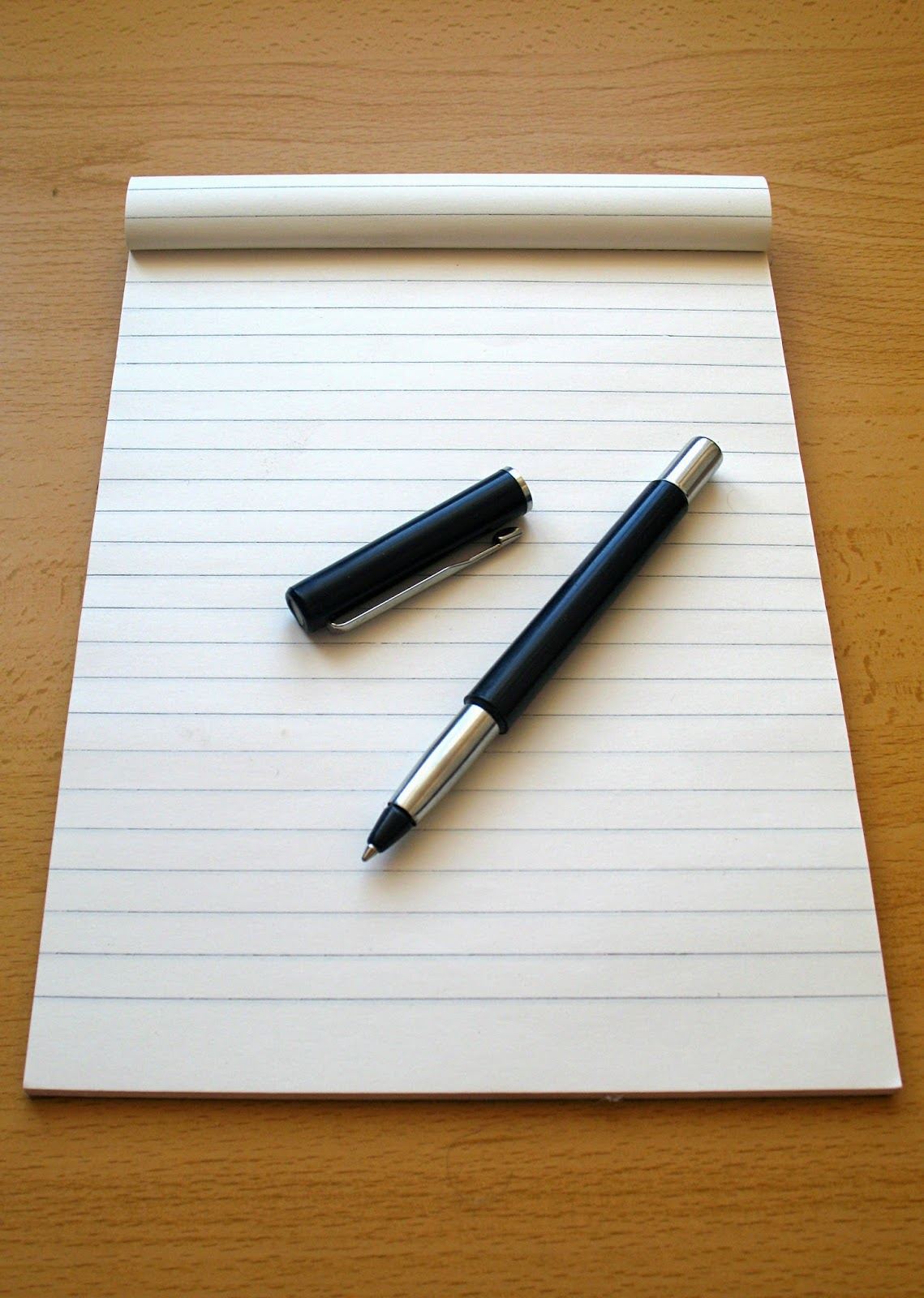 a picture of a pen on a paper notebook