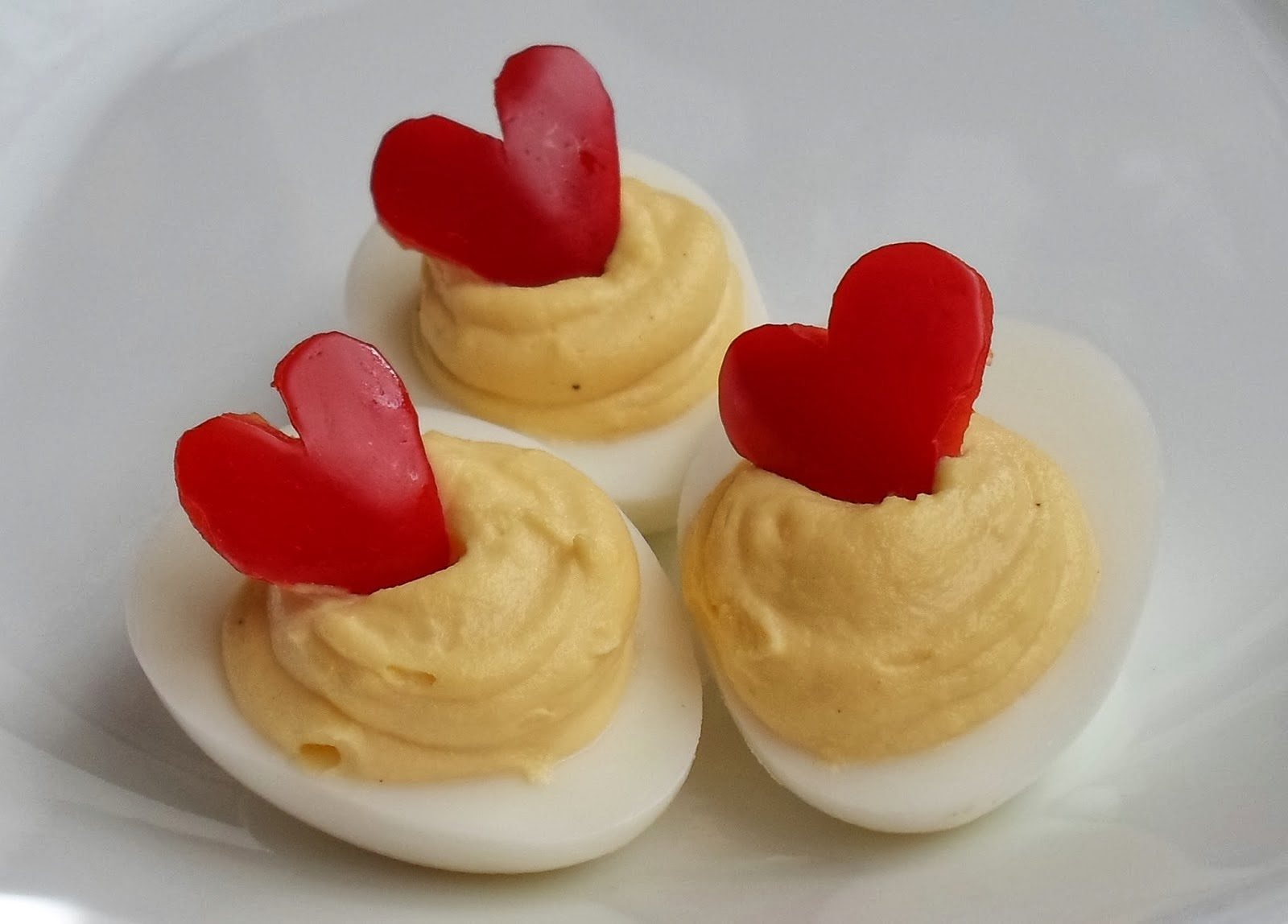 http://happierthanapiginmud.blogspot.com/2014/01/red-bell-pepper-heart-deviled-eggs.html