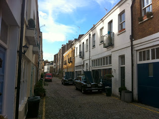 Old cars on Radley Mews, Kensington, London W8