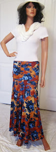 Ladies Abstract Blue Flowers on a Rust background, Stretch Jersey Knit Maxi