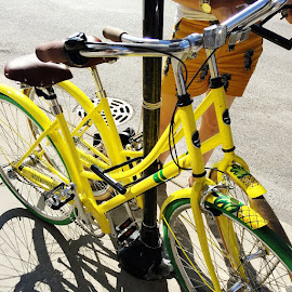 Bright yellow and green bikes for guests from the StayPineapple Hotel