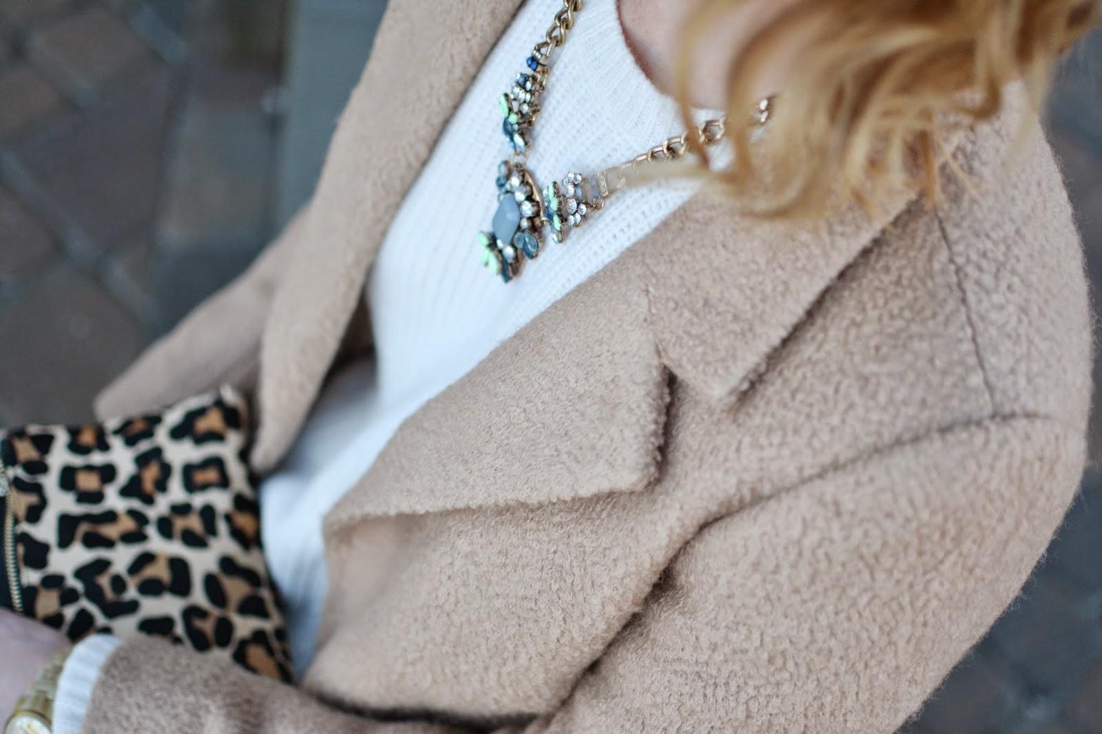 statement necklace, cream sweater, black pants, leopard purse,