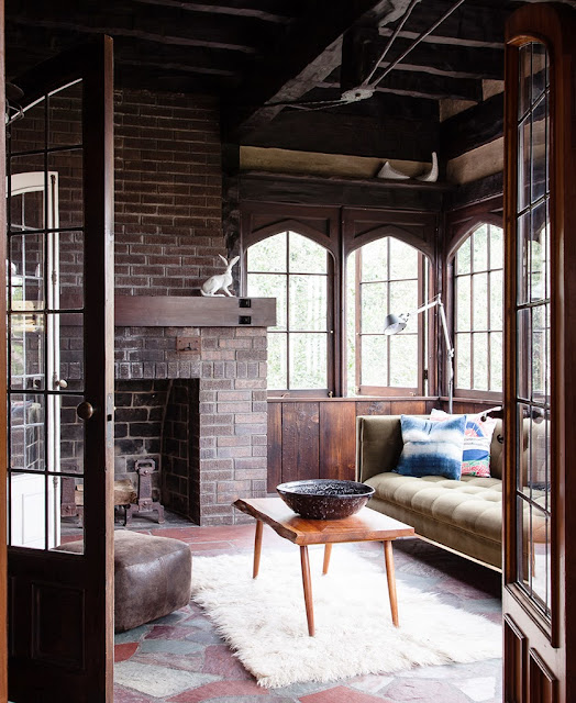 Exposed brick wall in a Los Angeles living room