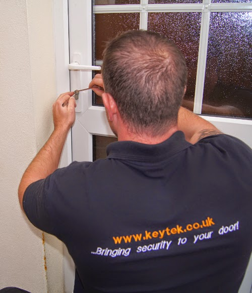 Highly skilled and trained locksmith working on a uPVC door