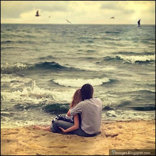 hug  beach  couple  wa...