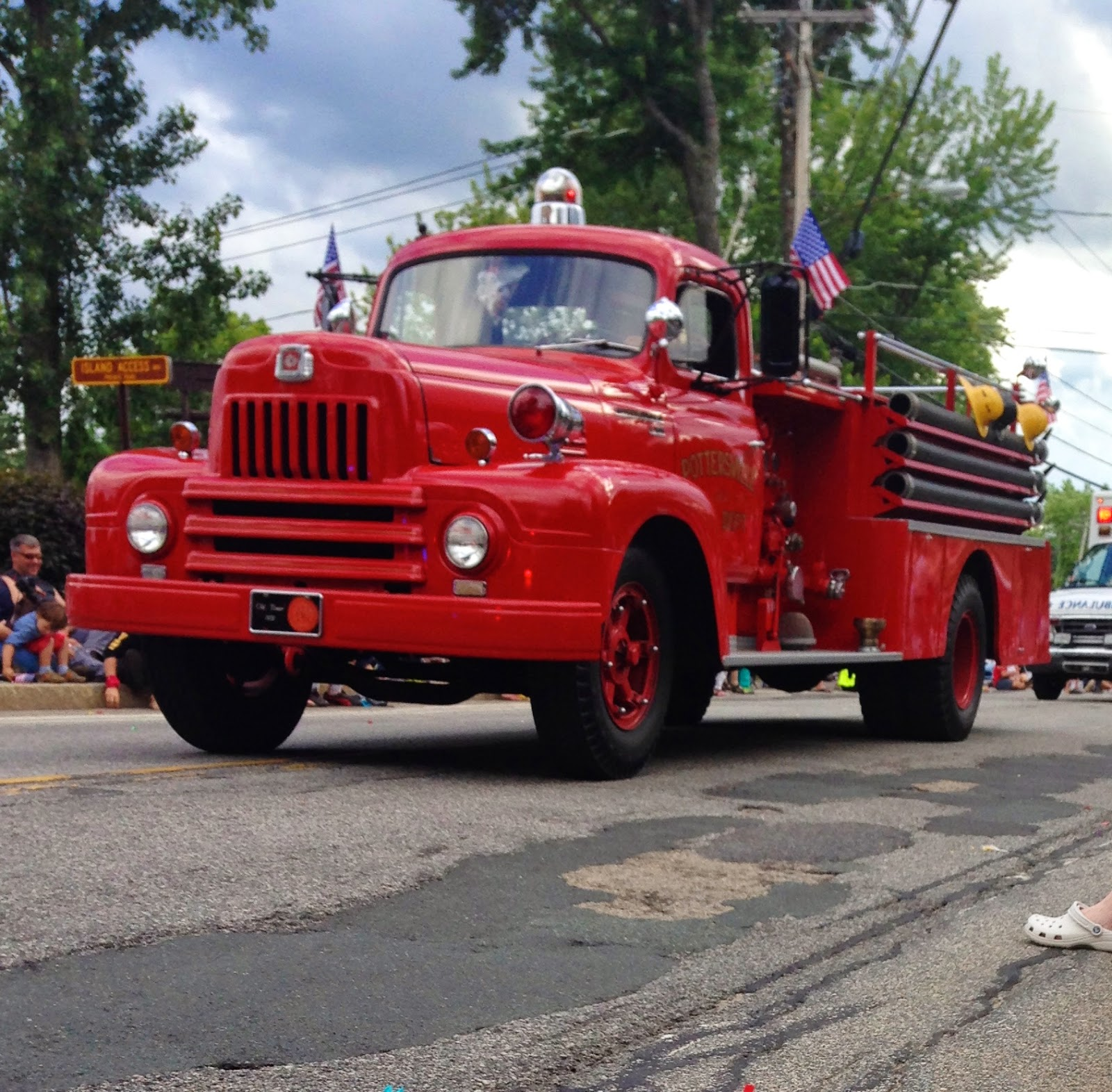 Old red fire truck in Schroon Lake 4th of July parade-www.goldenboyandme.com