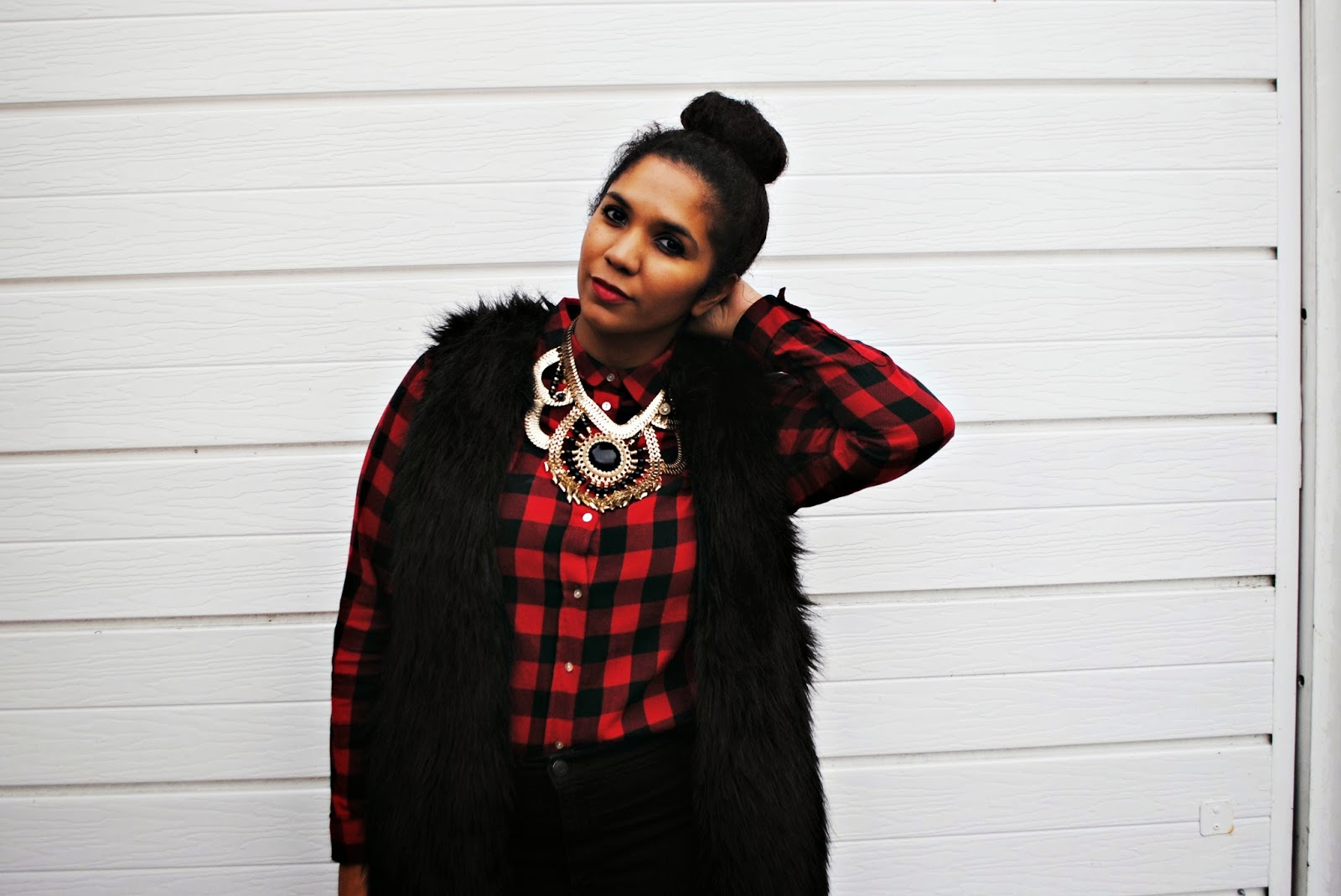 Lumberjack shirt layered with a fur gilet