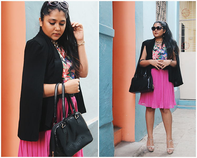 Styling a cape blazer with pleated skirt and tropical blouse