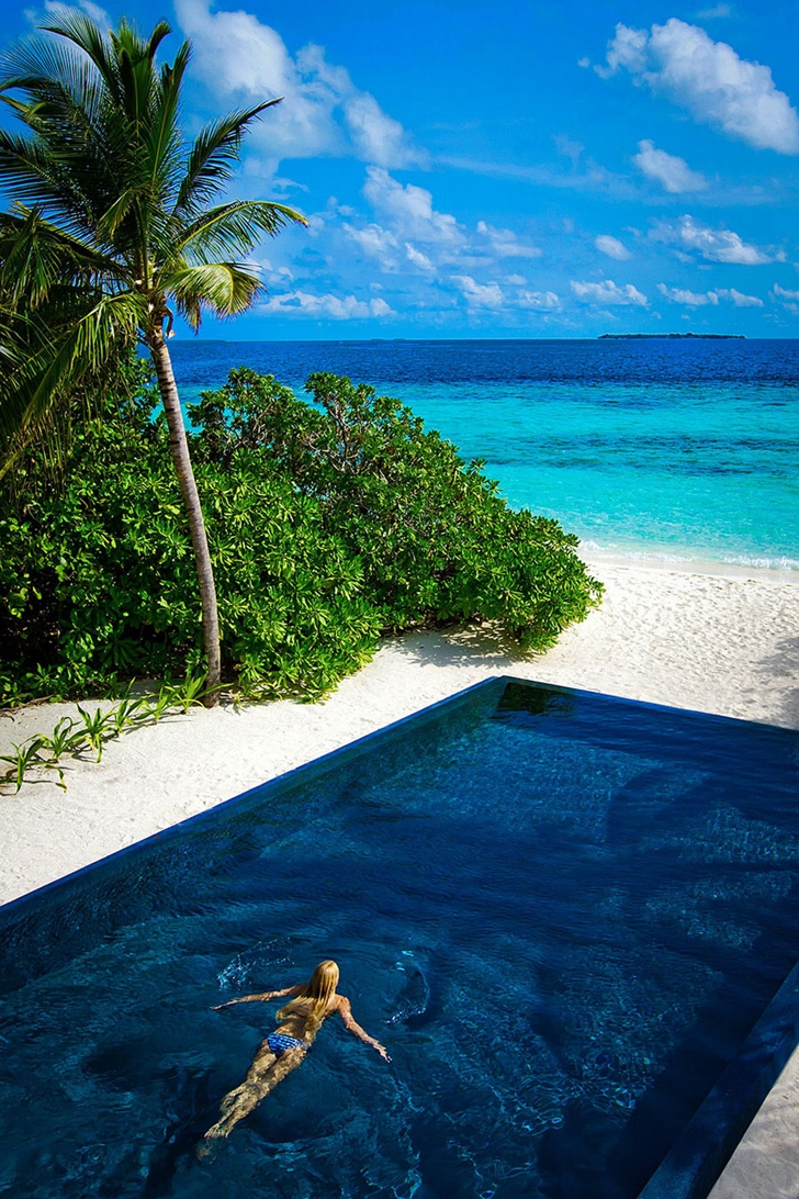 Swimming pool on the beach in Luxury Dusit Thani Resort in Maldives