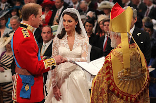 The couple gazes loving at each other. At the alter, Will whispers to his glowing bride, 'You look beautiful.'