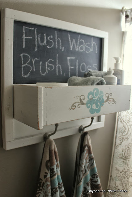 Beyond the Picket Fence Under $75 bathroom makeover and towel hook organizer http://bec4-beyondthepicketfence.blogspot.com/2013/10/how-to-freshen-up-bathroom-for-under-75.html