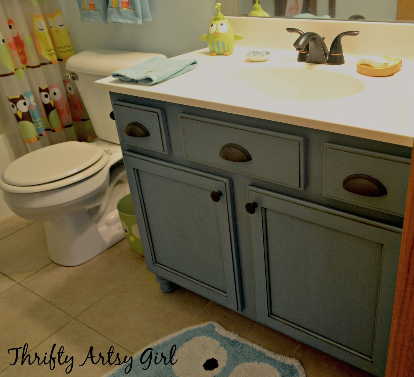 builders grade teal bathroom vanity and faucet upgrade for only 60 thrifty artsy girl