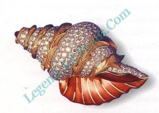 A brooch of diamonds and enamel in the form of a conch shell.