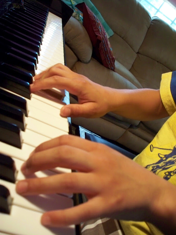 Kids learning piano helps brain development