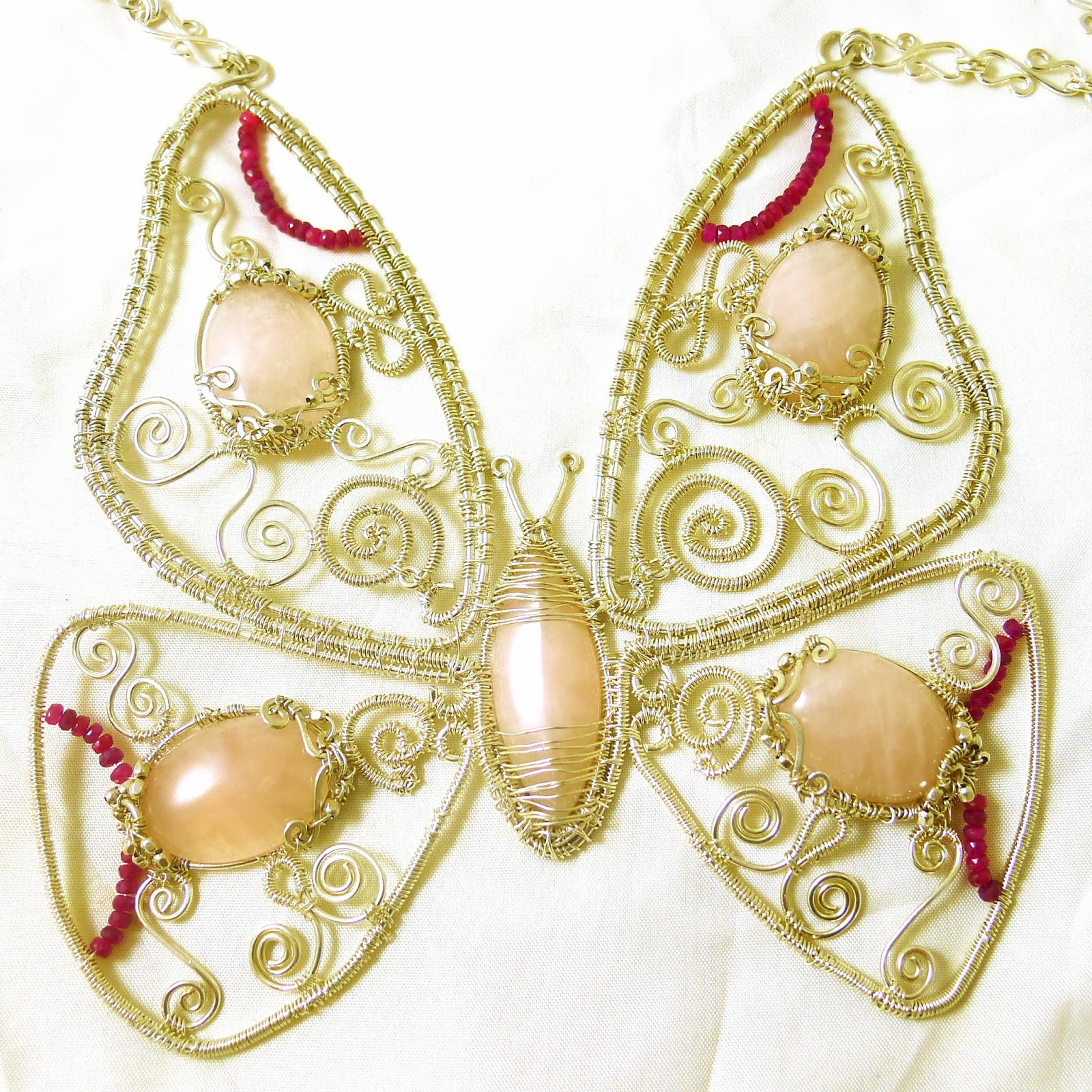 https://www.etsy.com/nz/listing/128634992/rose-quartz-filigree-butterfly-necklace?ref=shop_home_active_8