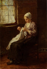 Mending by the window