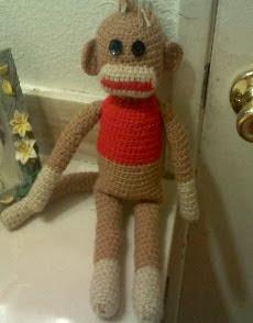 http://tawanascutecrochet.weebly.com/uploads/5/6/8/9/5689384/mick_the_sock_monkey.pdf