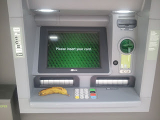 Banana sitting on ATM maching