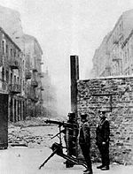 HEAVILY ARMED NAZIS GUARDING ENTRANCE TO WARSAW GHETTO