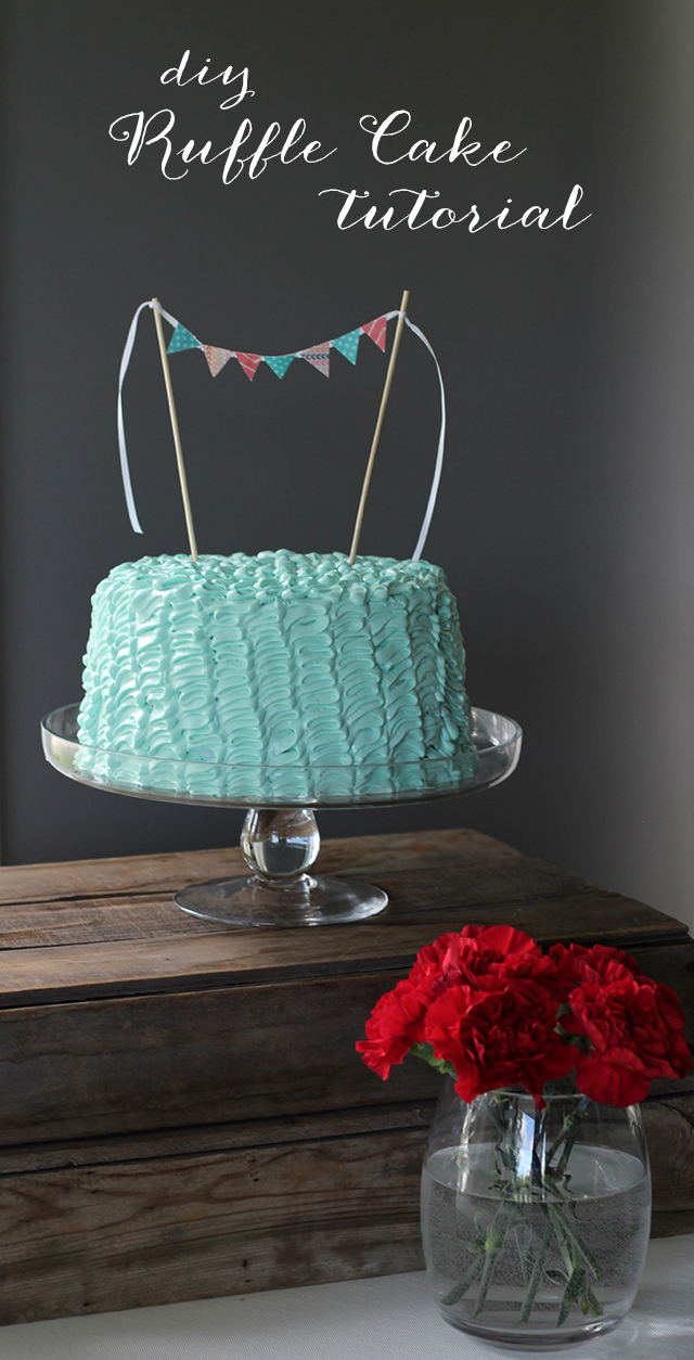 Aqua blue ruffle cake with mini paper bunting topper.