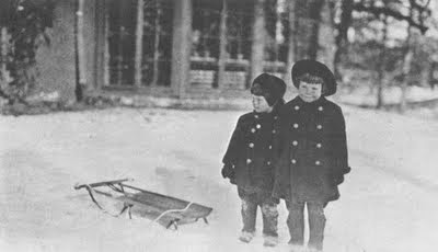 Katharine Hepburn and her big brother Tom  go sledding at their home in Hartford, CT.