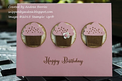 A simple pink birthday card with a row of three cupcakes.