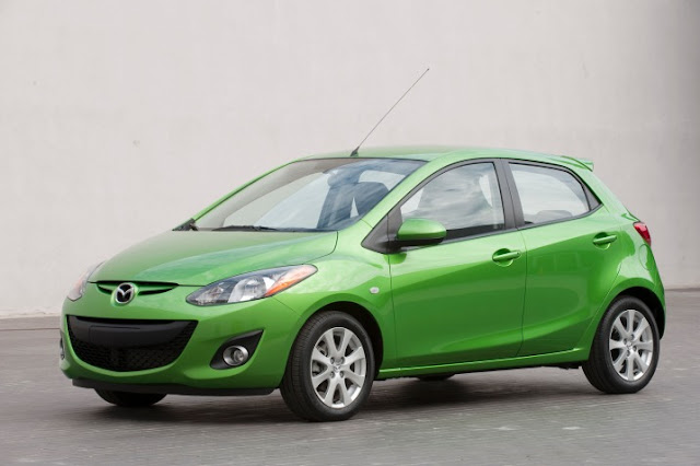Front 3/4 view of green 2011 Mazda 2