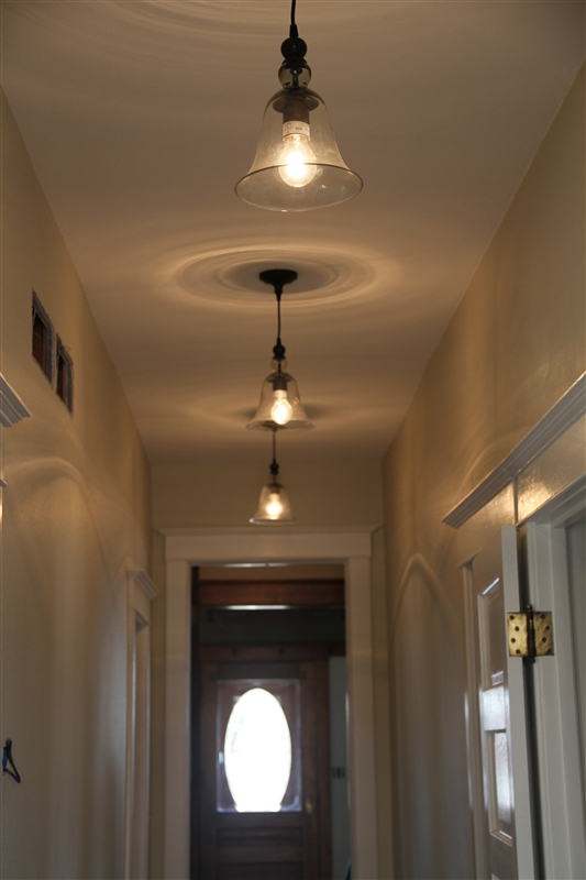 we added new pb rustic glass pendants in the hallway downstairs