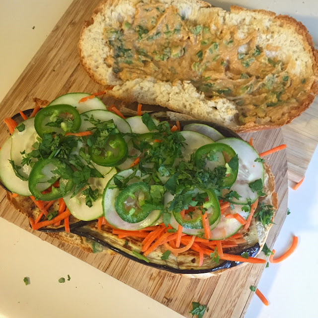 Pickled veggies and eggplant on crunchy, chewy bread