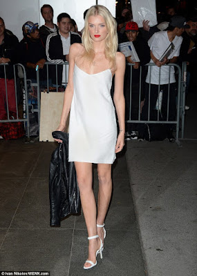 Lily Donaldson goes braless in negligee-style silk dress at WSJ bash