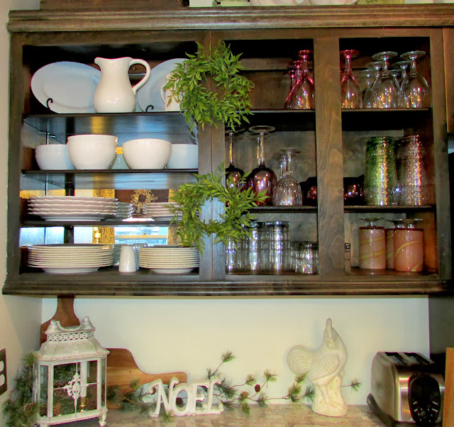 Stylish Kitchen Cabinets decorated for the Holidays