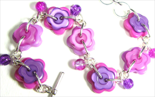 Bright bracelet is made with colorful flower buttons and cute crackle beads