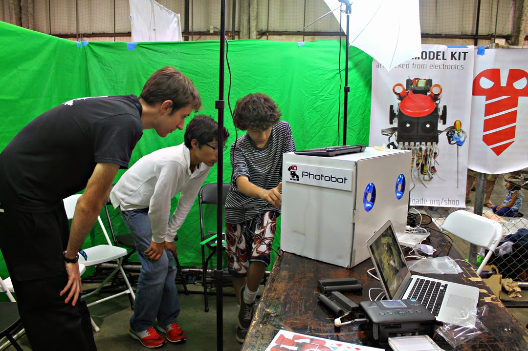 PhotoBot staffer helps Event City staff to use photobot