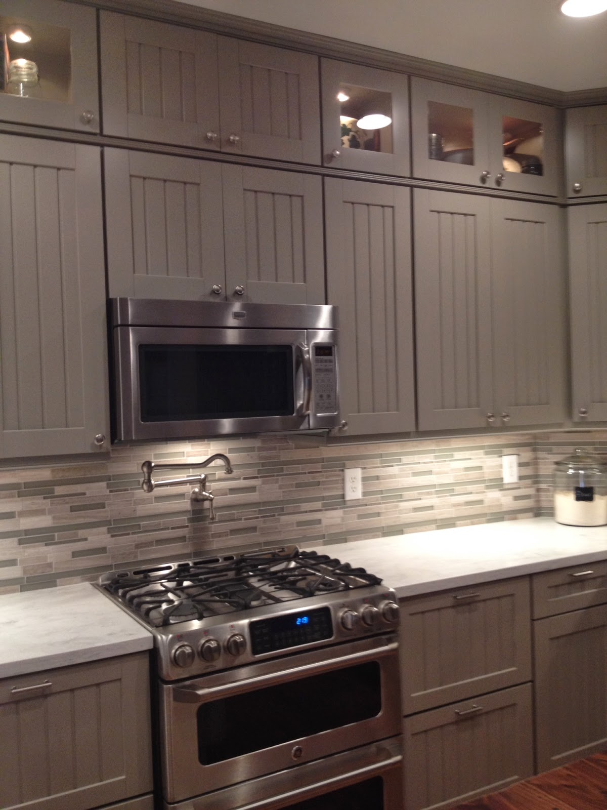 Weathered pieces kitchen remodel with martha stewart cabinets for Pictures of kitchen cupboards