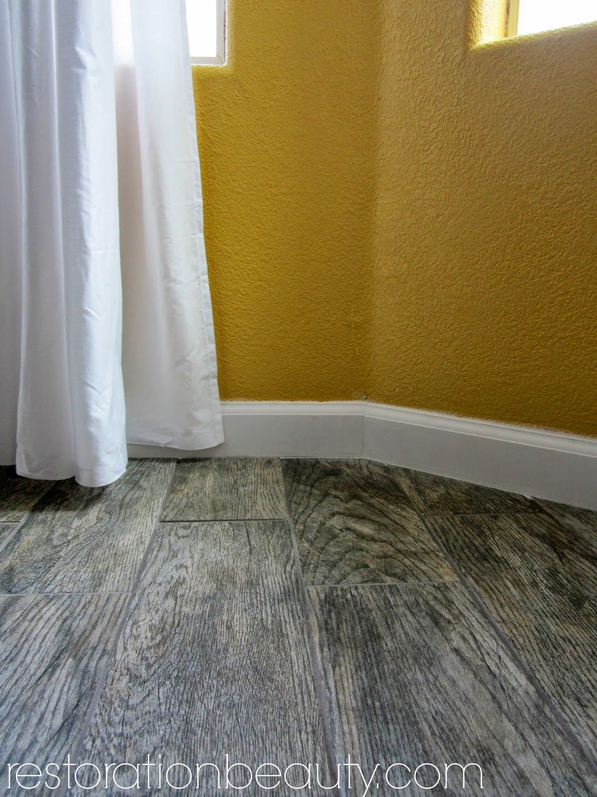 Restoration beauty faux wood tile flooring in the kitchen dailygadgetfo Choice Image