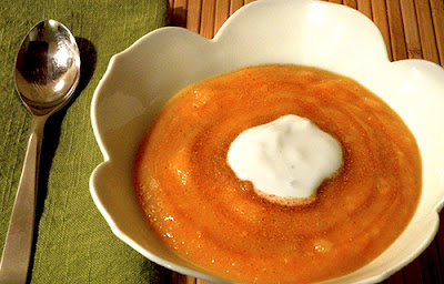 Bowl of Honey Butternut Soup with Honey and Yogurt Garnish
