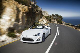 white ferrari car on road mountain view
