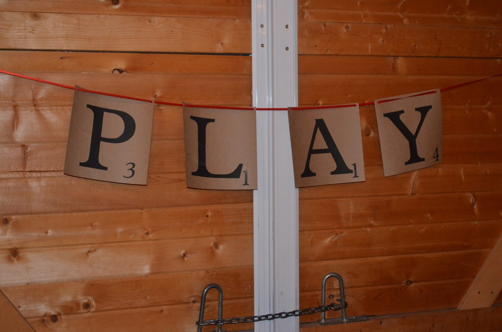 she picked a scrabble theme and everything turned out so cute we made giant scrabble tile signs that said play eat drink dance and love