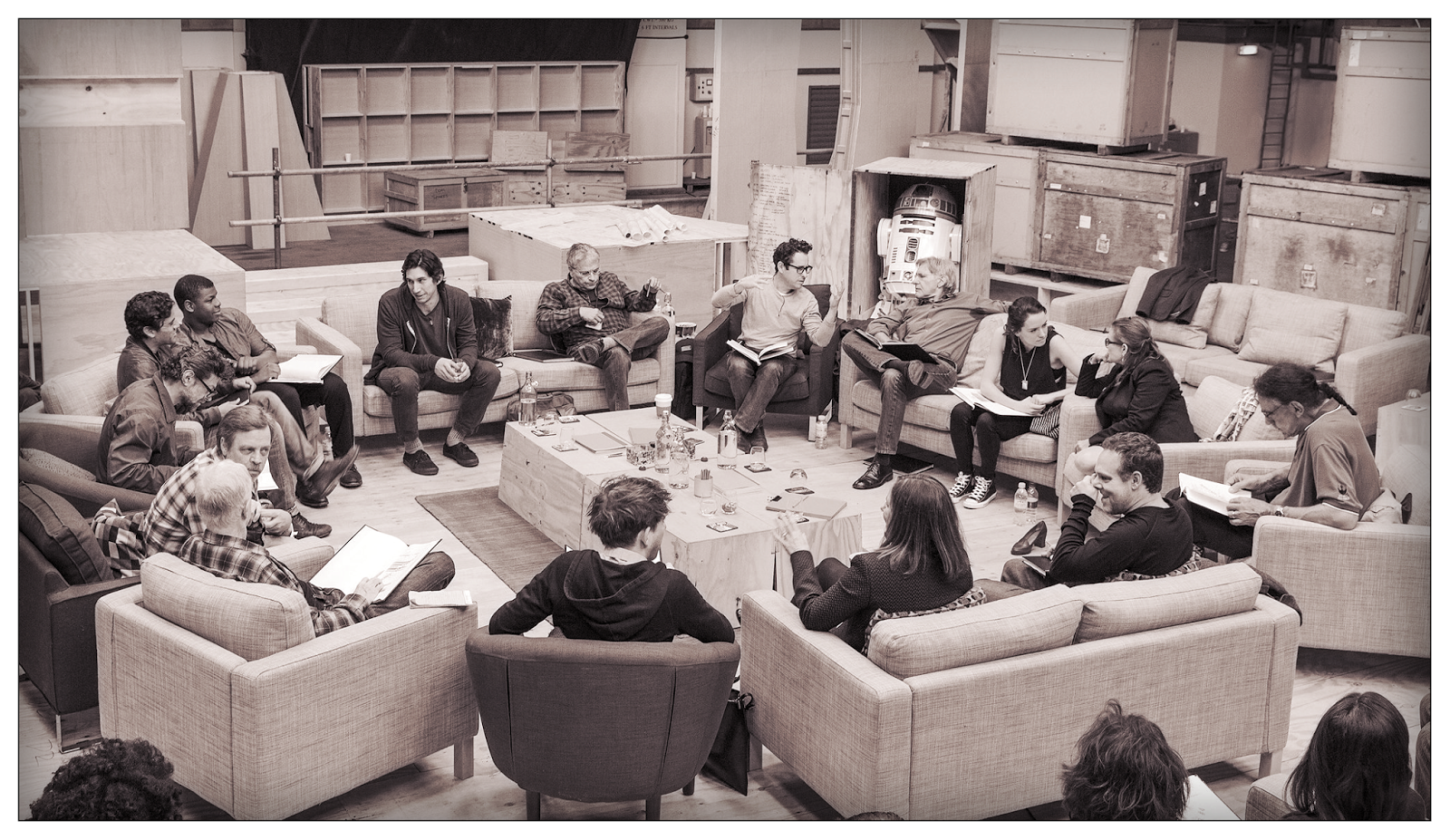April 29th, Pinewood Studios, UK - Writer/Director/Producer J.J Abrams (top center right) at the cast read-through of Star Wars Episode VII at Pinewood Studios with (clockwise from right) Harrison Ford, Daisy Ridley, Carrie Fisher, Peter Mayhew, Producer Bryan Burk, Lucasfilm President and Producer Kathleen Kennedy, Domhnall Gleeson, Anthony Daniels, Mark Hamill, Andy Serkis, Oscar Isaac, John Boyega, Adam Driver and Writer Lawrence Kasdan.