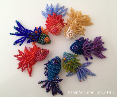 a circle of Fancy Fish beadwoven sculptures by Karen Williams