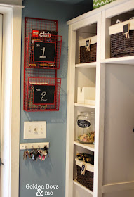 Wire basket in mudroom to store books.  www.goldenboysandme.com
