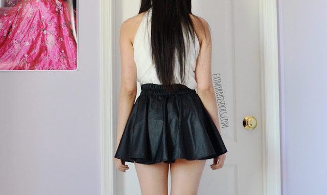 Back views of Dresslink's 2-way ribboned white blouse, worn with a black leather skater skirt.