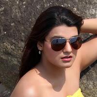 Tashu kaushik latest hot photoshoot stills in yellow at beach