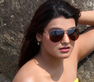 Tashu kaushik latest hot photoshoot stills in yellow at beach