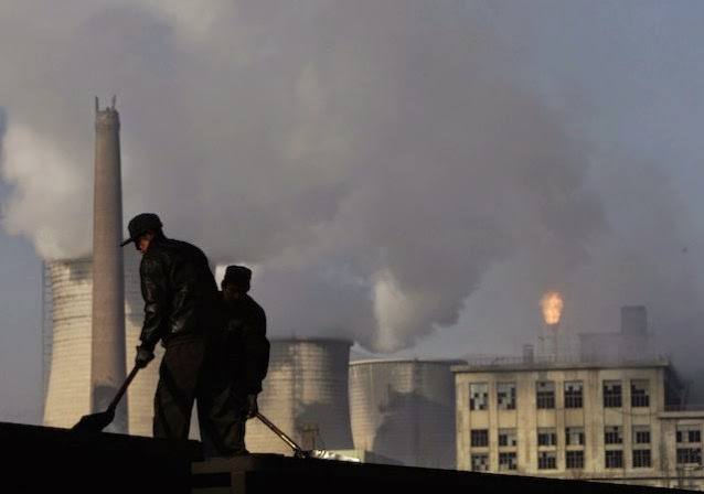 Miners shovel coal at a north China mine near a power plant and chemical factory. (Credit: AP/Oded Balilty) Click to Enlarge.