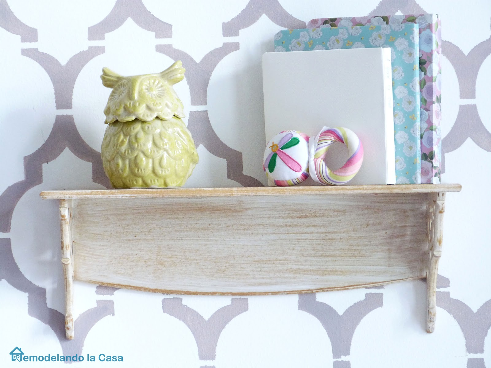 shelf with owl and baby toys for nursery