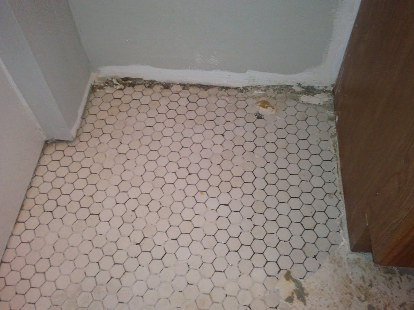 Sand paper and a fresh layer of grout it will look like new